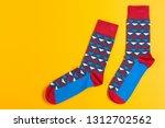 two multi colored men's socks... | Shutterstock . vector #1312702562