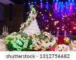 wedding cake  on flower near... | Shutterstock . vector #1312756682