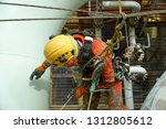working at height. aerial view... | Shutterstock . vector #1312805612
