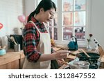 young girl in apron holding... | Shutterstock . vector #1312847552