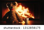 a bear cub with a cup of tea... | Shutterstock . vector #1312858175