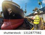 stevedore  port controller ... | Shutterstock . vector #1312877582