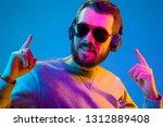 enjoying his favorite music.... | Shutterstock . vector #1312889408