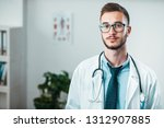 portrait of young doctor on the ... | Shutterstock . vector #1312907885