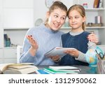 cheerful girl and her young... | Shutterstock . vector #1312950062