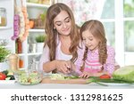portrait of mother and daughter ... | Shutterstock . vector #1312981625