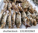 crab on ice sold in supermarket | Shutterstock . vector #1313032865
