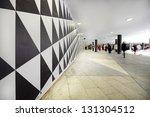 Pedestrians on city sqare, motion blur - stock photo