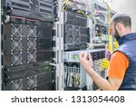 technician repairs the central... | Shutterstock . vector #1313054408