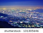"View of several Japanese cities in the Kansai region from Mt. Maya. The view is designated a ""Ten Million Dollar Night View."" - stock photo"