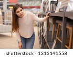 young beautiful woman examining ... | Shutterstock . vector #1313141558