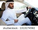 driving arab man   Shutterstock . vector #1313174582