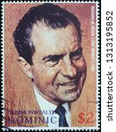 Small photo of Milan, Italy - February 11, 2019: Portrait of President Nixon by Norman Rockwell on stamp