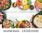 buddha bowl on a white wooden... | Shutterstock . vector #1313211032