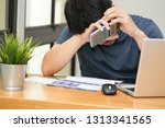 asian man stressed while... | Shutterstock . vector #1313341565