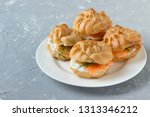profiteroles with cheese and... | Shutterstock . vector #1313346212