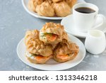 profiteroles with cheese and... | Shutterstock . vector #1313346218