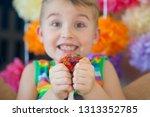 kid holding stress relief grape ...   Shutterstock . vector #1313352785
