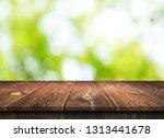 empty wooden table background | Shutterstock . vector #1313441678