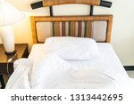 rumple pillow on bed decoration ... | Shutterstock . vector #1313442695