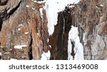 freezing waterfall. big icicles ... | Shutterstock . vector #1313469008