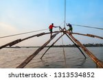 unidentified fishermen and... | Shutterstock . vector #1313534852