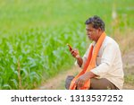 indian farmer using mobile... | Shutterstock . vector #1313537252