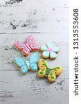 butterfly shaped icing sugar... | Shutterstock . vector #1313553608