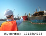 hand finger of harbor master... | Shutterstock . vector #1313564135