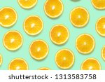 orange slices on a colored... | Shutterstock . vector #1313583758