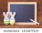 egg bunnies  before  a empty... | Shutterstock . vector #1313675225