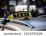 taxi sign  | Shutterstock . vector #1313707628