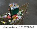 overflowing trash bin filled... | Shutterstock . vector #1313738345