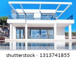 luxury modern white house with... | Shutterstock . vector #1313741855