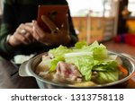 woman take a picture on hot pot ...   Shutterstock . vector #1313758118
