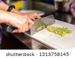 woman cut vegetables on the...   Shutterstock . vector #1313758145