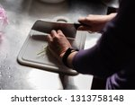 woman cut vegetables on the...   Shutterstock . vector #1313758148