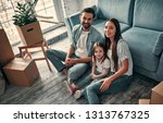 family on moving day.... | Shutterstock . vector #1313767325