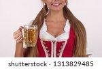 gorgeous oktoberfest woman in... | Shutterstock . vector #1313829485