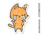 distressed sticker of a crying... | Shutterstock .eps vector #1313869265