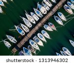 moored yachts   aerial view | Shutterstock . vector #1313946302