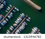 moored yachts   aerial view | Shutterstock . vector #1313946782