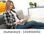 young woman using laptop on... | Shutterstock . vector #1314026552