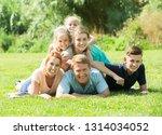 portrait of big friendly family ... | Shutterstock . vector #1314034052