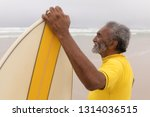 side view of happy senior male... | Shutterstock . vector #1314036515