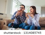 beautiful young couple eating... | Shutterstock . vector #1314085745