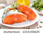 fresh raw salmon fish steaks on ... | Shutterstock . vector #1314150635