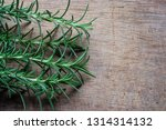 rosemary plant on wooden rustic ... | Shutterstock . vector #1314314132