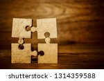 4 four brown pieces of puzzle...   Shutterstock . vector #1314359588