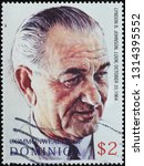 Small photo of Milan, Italy – February 11, 2019: Portrait of President Johnson by Norman Rockwell on stamp